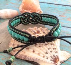 *****I WILL BE ON VACATION JUNE 25- JULY 6....YOU MY MAKE A PURCHASE DURING THIS TIME HOWEVER, YOUR ITEM WILL NOT BE SHIPPED UNTIL JULY 7- THANK YOU!*****  Beaded Josephine Knot Bracelet, Leather Beaded Cuff, Turquoise Jewelry, Adjustable Bracelet, Knot Cuff, Knot Bracelet, Unique Jewelry  New Sunset Southpaw design! Featuring 6mm Turquoise Fire Polished beads and 8/0 Opaque Turquoise Picasso Seed beads handwoven onto black leather cord with a beaded Josephine knot in the center. This…