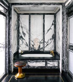 The Calacatta marble-clad bathroom of a Chicago abode begs the question, is the bathroom the new boardroom? Pick up our December issue for our take. | Photo: @thefacinator; Design: @stevengambrel