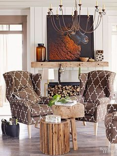 A large, graphic painting transforms this timeworn mantel. Neutral objects such as a brown jug, a small basket, and found objects let the painting be the center of attention while still making the mantel feel complete.
