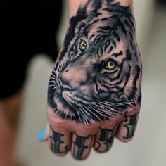 Yellow Eyes Tiger Head Tattoo On Left Hand
