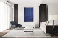 Sala de estar com sofá branco, quadro azul, tapete cinza e mesa de centro de mármore com poltrona preta
