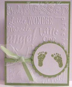 handmade baby card ... white with light green accents ... background embossed with embossing folder with words for baby ... stamped baby feet on focal medallion ...