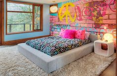 Bedroom offers a cool and eclectic look thanks to the graffiti wall [Photography: Shouldice Media]