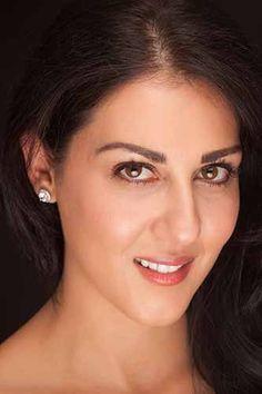 Samira Mohammed Ali as Dr Elizabeth Santer