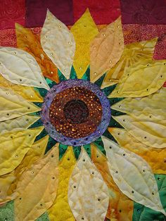 fun sunflower quilt-- I have this pattern, because I definitely need at least one more sunflower thing in my house.