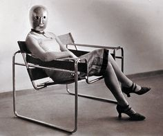 Erich Consemüller - Woman in B3 club chair by Marcel Breuer wearing a mask by Oskar Schlemmer and a dress in fabric designed by Lis Beyer, Bauhaus, 1926