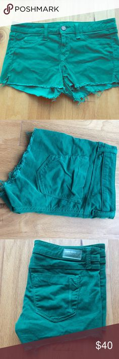 "Green Courdory Cutoff ""Baby Short"" Shorts The photographs do not do the shorts any justice!! They are very bright green, like St Patrick's Day green. They are labeled a 28, but run small and fit like a 27. Fade to Blue Shorts"