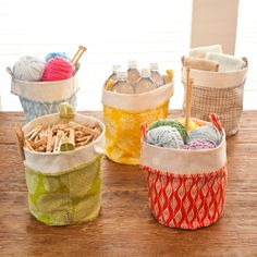 """Fabric buckets:      Eco-Friendly      Printed on recycled canvas      Printed with soy-based inks      Looped handle on each side      Measures 11.25h x 7.25"""" Diameter      Measures 8.5h x 7.25"""" Diameter folded at handles"""