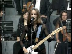 Sheryl Crow and Eric Clapton - Run Baby Run (Pavarotti and Friends - 1996 - live).  Fantastic!