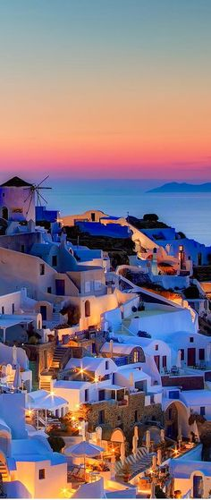 Santorini ~ set against the azure of the Agean Sea on whitewashed cliff overlooking the caldera, Greece