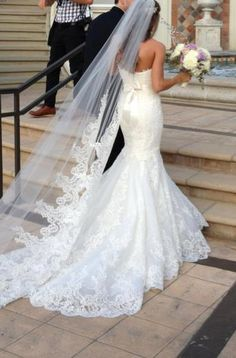 Ultra Sexy Fitted Mermaid Lace Wedding Gown.  I love the Cathedral veil and the bow on the back of the dress! #Sexy #Wedding #Dress #Lace