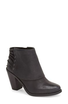 Love how skinny laces wrap around the back of this chunky stacked heel bootie.