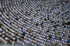 People in prostration toward the Kaaba