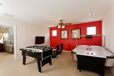 Game room with foosball & air hockey tables in an Acadia Estates vacation home