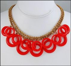 Art Deco necklace: brass with bakelite rings. Bakelite, the first synthetic plastic, was introduced in 1909 and used in jewelry through the 1940's.