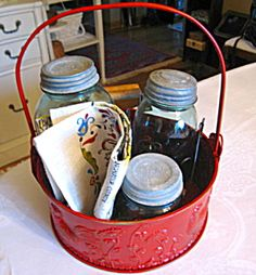 Vintage Ball Mason Jars and more in a red rooster basket for sale at More Than McCoy on TIAS!