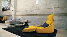 side view of yellow Hosu Lounge Seating with fold out foot rest in the office lounge space