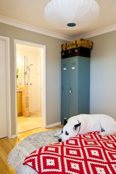 """Maya's bedroom - A quirky retreat with vintage lockers as shoe storage.  Walls painted with Dulux """"Still"""" in half-strength."""