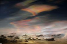 The clouds are usually seen over Norway and other polar regions, when the sun is just below the horizon. Here, birds fly near Whitley Bay in Northumberland, below the nacreous clouds on the coastline. It is thought that recent storms may have increased the chances of the clouds forming over the UK, by driving moisture up into the stratosphere.