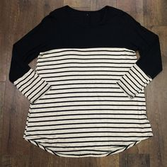 On it's own or layered with something, like one of our cute vests, this top is a must have! Stripes are a wardrobe basic, no such thing as too many.. says the girl with 14 black and white striped tops