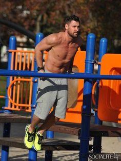 Shirtless Maksim Chmerkovskiy breaks a sweat at an LA park wearing Skechers Sport sneakers.