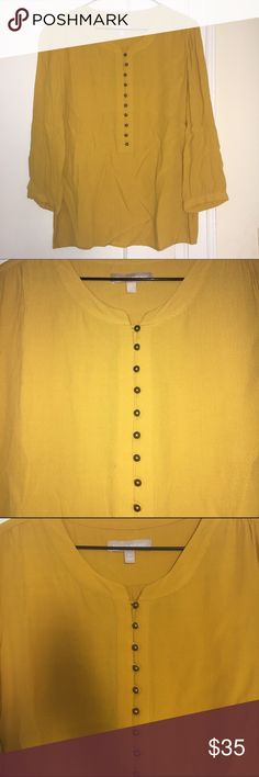 Banana Republic blouse Banana Republic mustard blouse with gold button accent down front and a button on each sleeve as well. Size M and falls just below waist so great shirt with jeans or for work. Perfect condition. Banana Republic Tops Blouses