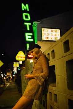The model poses in a motel for the fashion editorial
