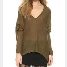 """Free People Sadie Sweater Dolman Loose Fit Wool L  Free People   """"Sadie"""" sweater - V-neck. Long dolman sleeves with ruched detail. Sharkbite hem. Lightweight. See through. Loose fit.   Size Large   39% wool, 32% acrylic, 22% nylon, 7% alpaca   Excellent used condition!   Olive green   Bust: 28"""" across the front, lying flat. Sweater has stretch.   Length: 25"""" from shoulder to hem.   ✳️ Bundle to Save 20%!  ❌ No Trades, Holds, PP   100% Authentic!    Suggested User // 700+ Sales // Fast…"""