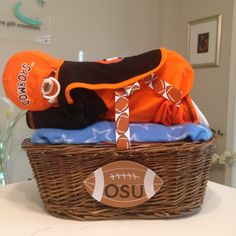 Custom OSU Cowboys Diaper Baby Basket! Perfect for a baby shower gift, a baby shower centerpiece, a hospital gift or nursery decor.  Want to customize or personalize your gift? Ask us how!  Now offering hospital delivery! www.everythingandthebaby.com