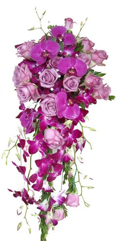 Cascade wedding bouquet with purple phalaenopsis orchids, dendrobium orchids, lavender roses accented with diamonds. floral@kuhlmanns.com