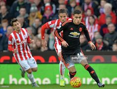 Manchester United's Belgian midfielder Andreas Pereira (R) runs with the ball during the English Premier League football match between Stoke City and Manchester United at the Britannia Stadium in Stoke-on-Trent, central England on December 26, 2015. Stoke won the game 2-0. AFP PHOTO / PAUL ELLIS No use with unauthorized audio, video, data, fixture lists, club/league logos or 'live' services. Online in-match use limited to 75 images, no video emulation. No use in betting, games or single…