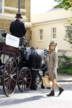EMMA JANE KNIGHT's 100% top quality cashmere taupe skirt, sweatshirt, scarf and gloves set in with #HenryandJames horse and carriage in Belgravia, London