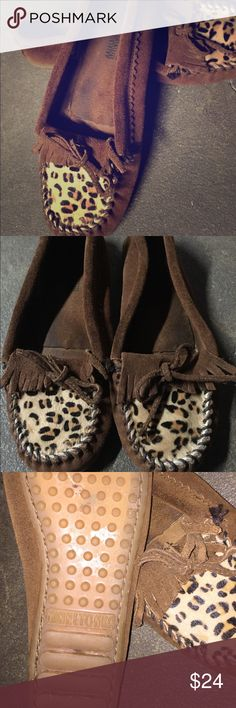 Minnetonka leopard moccasins Lots of life left in these adorable moccasins. Minnetonka brands suede with faux leopard fur, size 6 1/2- also fits a 7. Minnetonka Shoes Moccasins