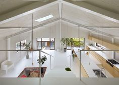 The former warehouse turned family residence in Yoro, Japan features a large open space with the kitchen as the center of the house.