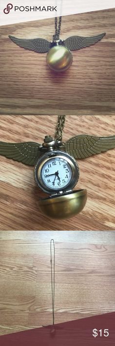 Harry Potter golden snitch clock necklace Never been worn! In excellent condition just needs a new battery. Nice long chain and a gold bronze color Jewelry Necklaces
