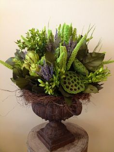 Custom Dried Floral Arrangement including: artichokes, lavender, china millet, pods, lemon leaf and preserved boxwood