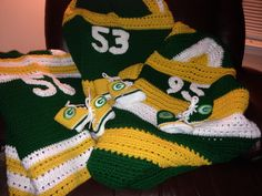 Hooded blankets and converse style booties for new Packers babies!