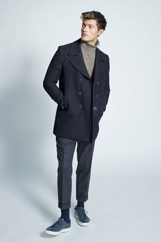 To look like a stylish dandy at all times, try pairing a black pea coat with charcoal wool dress pants. Navy leather low top sneakers add more character to an otherwise mostly classic ensemble. Black Pants, Black Socks, Black Pea Coats, Wool Pants, Wool Dress, Men Looks, Dress Pants, Suit Jacket, Turtleneck Dress