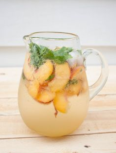 Peach Mojitos- 1 Cup of Sugar (mixed with ¾ cup of hot water to form simple syrup) 3 Peaches, pitted and sliced 1 bunch of mint leaves (about 1 cup of loose leaves) 6-8 oz White rum 3 Cans Lemon LaCroix Sparking Water 2 trays of ice (about 24 ice cubes)
