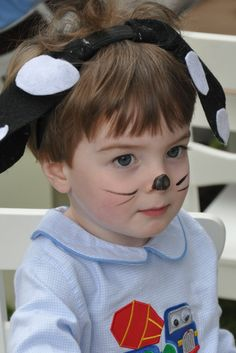 A dog face and dog ears is something fun for the kids to do. They could even make their own dog ears as an activity at the party.