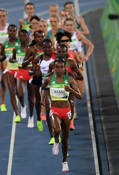 Ethiopia's Almaz Ayana leads the field in the Women's 5000m Final during the…