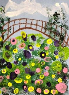 Kindergarten students learned about Claude Monet's art and the beautiful gardens he created around his home in France. Students used oil pastel to draw the bridge across Monet's pond and then used sponges to add the greenery. They used their fingers to add the colorful flowers on top of the lily pads.: