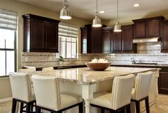 kitchen islands that seat 8   Kitchen with custom designed Island to seat 6.