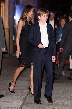 Trump was photographed leaving the famed eatery with his wife, Melania, and mini me son, Barron, who was sporting a navy blue colored suit, just like him (above)
