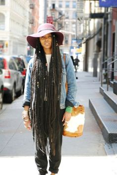 How cool is she, nearly trippin over her box braids...