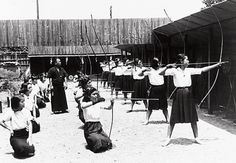 Kyudo being practiced by women at Doshisha Women's College of Liberal Arts in Kyoto, Japan. This photo was taken in 1941.