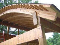 J. Ullman Carpentry LLC - Structures: Laminated curved timbers gave this structure a unique look and a spacious vaulted interior.