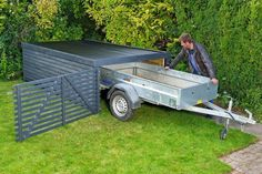 Gardens Discover Build a simple and cheap garage for the trailer Build a simple and cheap garage for the trailer Easy Garden Home And Garden Trailer Build Garage Shop Diy Pergola Shed Plans Garage Storage Outdoor Projects Outdoor Storage Garage Shed, Diy Garage, Garage Workshop, Garage Doors, Bike Storage, Garage Storage, Outdoor Storage, Kayak Storage, Garage Organization