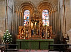 The retable of the High Altar is by Bodley with figures carved by Brindley in 1881.