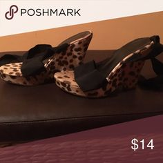 Leopard print shoes Newport News leopard print - slightly worn , good condition size 7.5. Ties around ankles Newport News Shoes Wedges